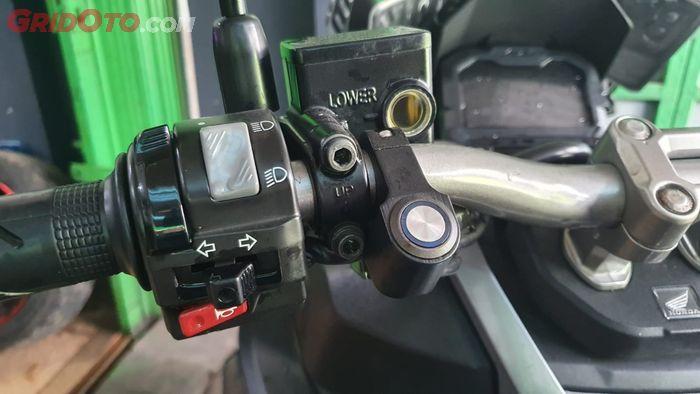 Switch tombol tambahan untuk lampu tembak di motor