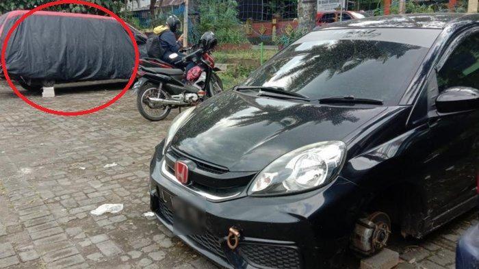 Dari kejauhan tampak roda Toyota Kijang LGX dan Brio dimaling saat parkir