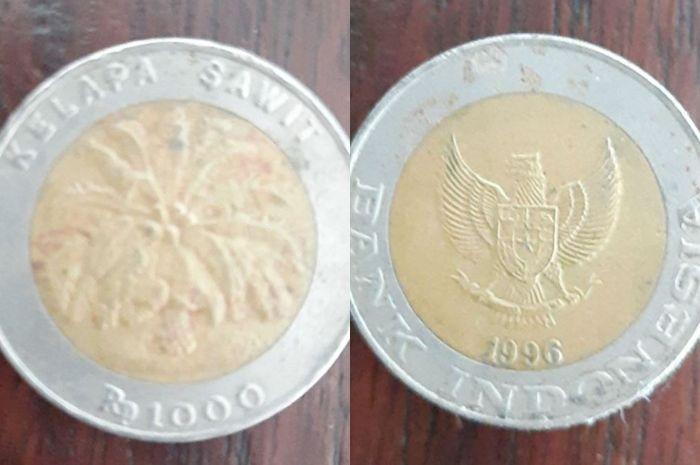 Uang koin Rp 1000 gambar kelapa sawit dijual lebih mahal dari motor matic premium.