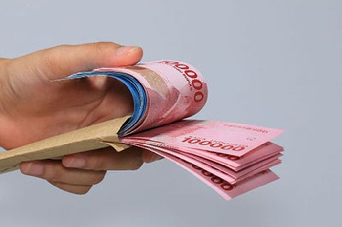 Ilustrasi uang tunai bantuan dari pemerintah.