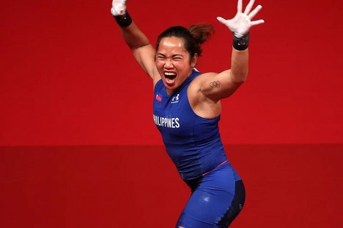 Hidilyn Diaz sukses meraih medali emas di cabang angkat besi putri 55 Kg Olimpiade Tokyo 2020