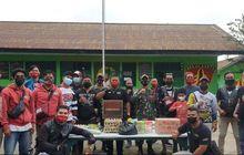 Mantap, Puluhan Bikers Kunjungi Kampung di Pelosok Papua untuk Berikan Bantuan Sosial
