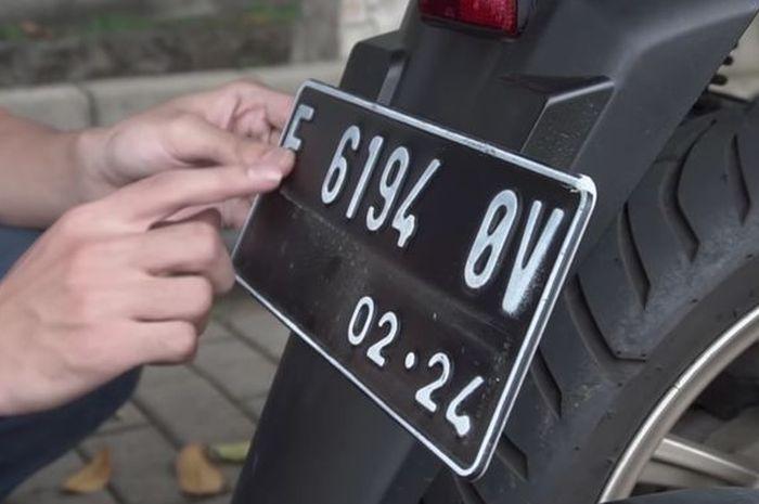Ilustrasi pelat nomor