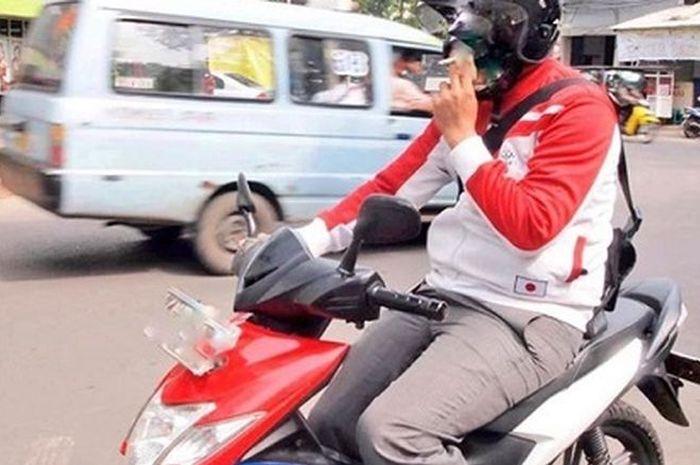 Himbauan kepolisian tentang merokok saat berkendara
